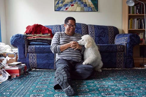 Andre Alexis in his home. (Photograph by Jaime Hogge)